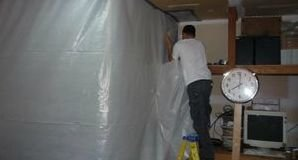 Disaster Restoration Tech Sealing Mold with Vapor Barrier
